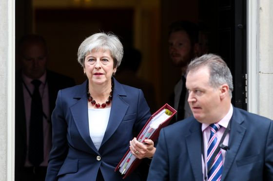 May's Mounting Workload: From Brexit Deal to Courting Opposition
