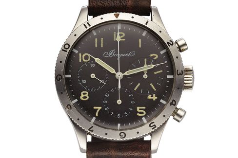 An unusual pilot's watch with an oversized minutes dial and bright luminous numerals.
