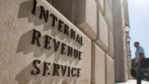 A man enters the Internal Revenue Service (IRS) building in Washington, D.C., U.S., on Friday, May 7, 2010.