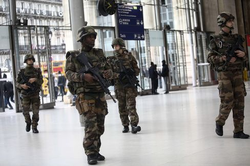 Members of the army patrol at the Gare du Nord train station