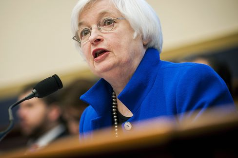 Fed keeps key rate unchanged but hints of coming hike