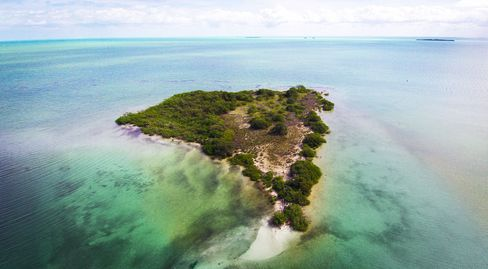 A seven-acre island for sale in Belize, offered by 7th Heaven Properties.