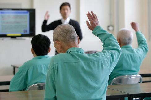 Inmates listen to a lecture by Takeshi Izumaru, director at the Nagasaki Community Support Center at Sasebo Prison in Sasebo, Nagasaki Prefecture, Japan.