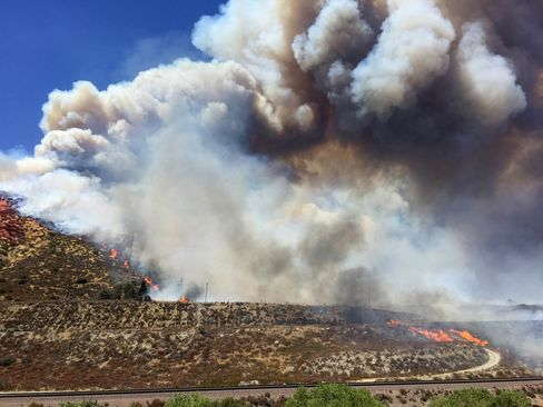 The Blue Cut fire throws up large plume of smoke shortly after it broke out in the Cajon Pass.