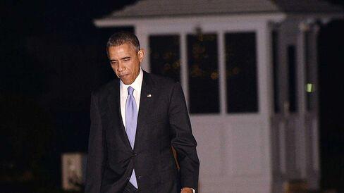 U.S. President Barack Obama walks to the White House on December 9, 2014 in Washington, DC.