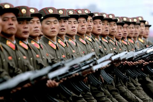 Members of the North Korean military march during a parade commemorating the 65th anniversary of the Korea Worker's Party in Pyongyang, North Korea