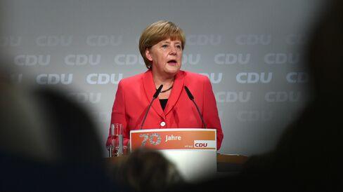 Chancellor Angela Merkel speaks in Berlin today