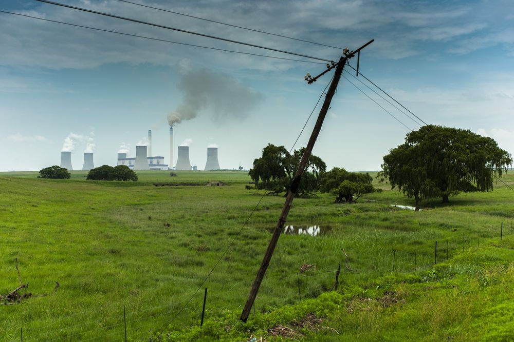 Emissions rise from the cooling towers of the Eskom Holdings SOC Ltd. Tutuka coal-fired power station in Mpumalanga.