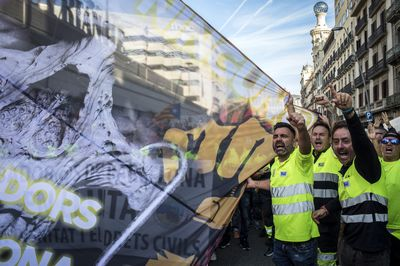 Striking port workers march through Barcelona on Tuesday