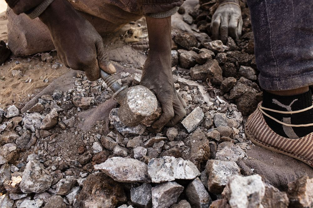 A miner breaks up small chunks of cobalt in the Democratic Republic of Congo.
