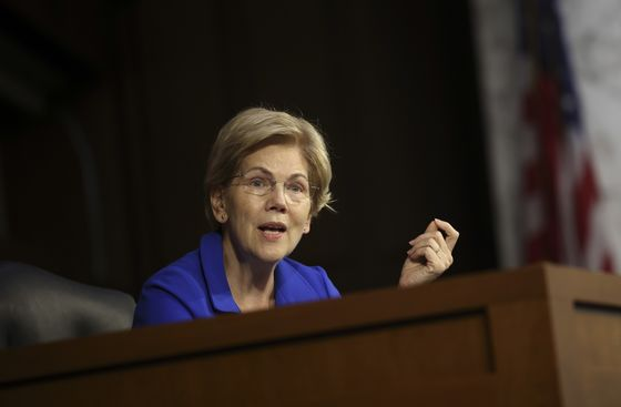 Warren Asks SEC to Investigate Trading by Fed Officials