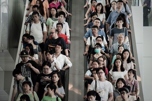 People take escalators in Hong Kong.
