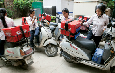 Some of the 250 Yakult Ladies gather before hitting the road
