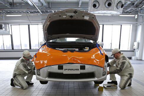 Staff Work On A Prius Vehicle