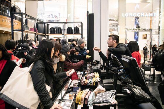 Black Friday's Handbag War Descends on Manhattan