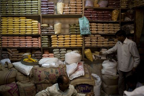 An assortment of grains and pulses including, Soya Beans, Chick Peas, Lentils and Kidney Beans, seen stacked on a shelf at a market in New Delhi.