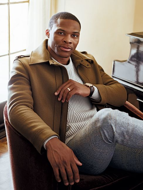 Jacket, $2,090, and sweater, $995, both by Lanvin; Prince of Wales check trousers by Michael Bastian, $695; El Primero Chronograph Classic watch by Zenith, $21,600.