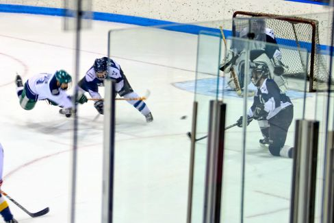 A Yale MBA candidate takes a shot on goal in a game among colleagues.