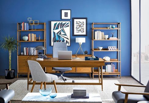 West Elm's midcentury executive desk with shelves and upholstered saddle chair.All the art's for sale, too.
