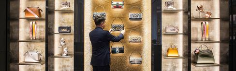 An employee adjusts a display of Baguette Bags at Palazzo Fendi.