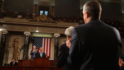 White House chief of staff Denis McDonough (right) and Secretary of State John Kerry applaud President Barack Obama as he delivers the State of the Union address at the U.S. Capitol in Washington on Jan. 28, 2014.