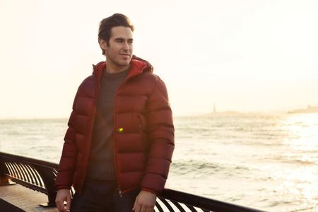 """Moore gravitated to this Devils-red puffer jacket by Moncler immediately, agreeing to wear it before even trying it on. """"I'm really into comfort and simple, quality things,"""" he says."""