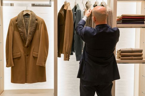 A mink and vicuna overcoat hangs in the Loro Piana store in Milan.