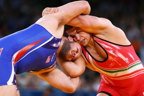 Fortress???s Mike Novogratz Brings Iranian Wrestlers to New York