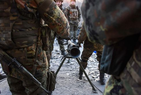 Fighters of the Azov Battalion prepare to fire an anti-tank weapon in the town of Shyrokyne, eastern Ukraine on Sunday, March 23. Government and Russian-backed separatist forces face off against one another across an unseen line cutting through the town in daily gun and artillery battles.