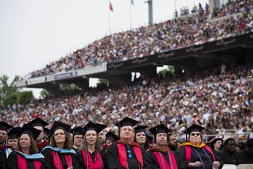 LYNCHBURG, VA - MAY 9Graduates wait for the start of the commencement ceremony at Williams Stadium, where Republican U.S. presidential hopeful and former Florida governor Jeb Bush delivered the commencement address, on the campus of Liberty University, May 9, 2015 in Lynchburg, Virginia. In his remarks, Bush criticized the Obama administration for being
