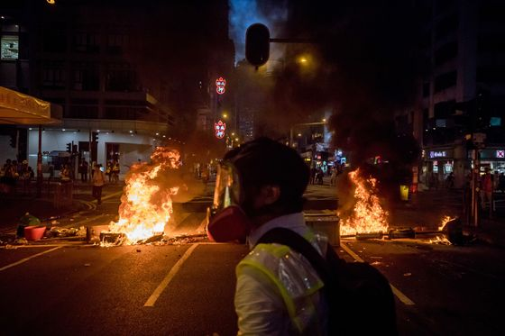 Hong Kong Protesters Battle Police, Set Fire to Key Subway Station
