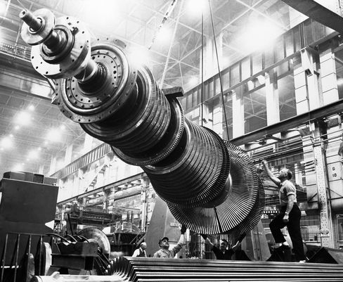 A turbine rotor, which is being hoisted by a giant crane at the General Electric turbine plant in Schenectady, N.Y., on Feb. 21, 1952. The heart of a turbine generator, the rotor weighs 42,200 pounds but has the precision of the finest watch.