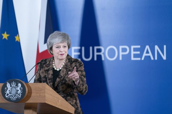 May Warns of No-Deal Brexit Dangers With Key Vote Weeks Away