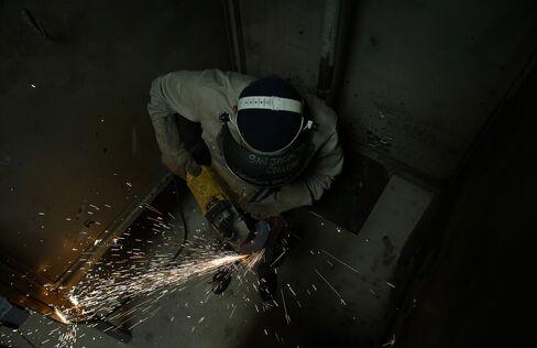 A Student Grinds Metal during a Welding Class