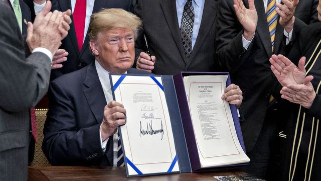 Trump Signs Biggest Rollback of Bank Rules Since Dodd-Frank Act