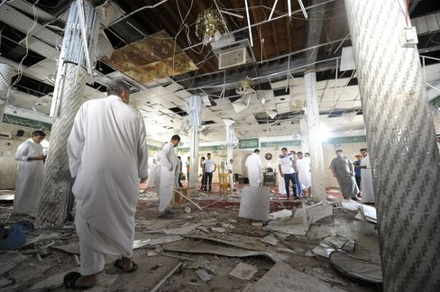 Men gather inside a mosque following an attack that left 21 people dead in Qatif on May 22, 2015. Photographer: Hussein Radwan/AFP via Getty Images