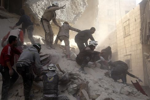 Civil defense team members rescue people from a wreckage in Aleppo.