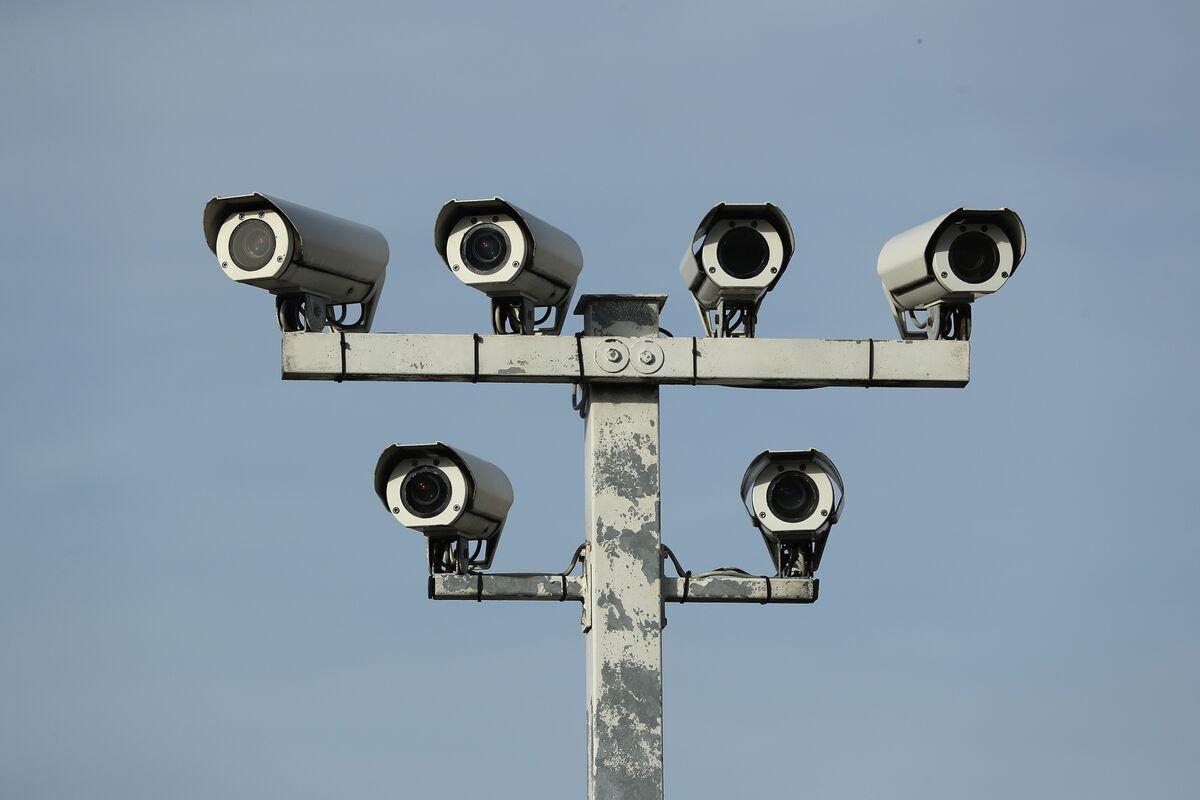 Spies, Cameras Shadow Corporate Lawyer on Island Getaway