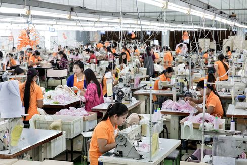 Workers toil over sewing machines at a Saha Pathana factory in Mae Sot.