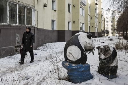 Statues of pandas and residential buildings.
