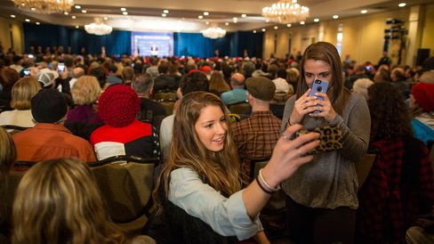 Attendees take selfies while Republican presidential candidate Donald Trump speaks on Jan. 29, 2016, in Nashua, New Hampshire.