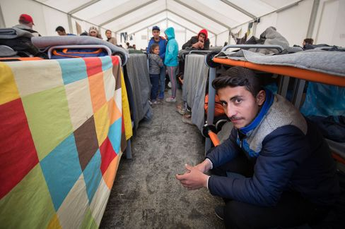 A man sits on his bunk bed inside a accommodation tent at the Idomeni refugee camp on the Greek Macedonia border on March 16.