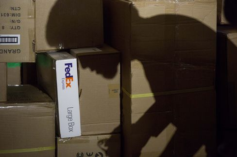 The shadow of a Package Handler at a FedEx Corp. Ground Hub