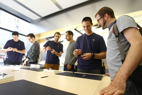 Apple employees demonstrate smartwatches at the store in Zurich