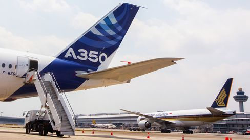 The Airbus A350 next to a Singapore Airlines plane in Singapore.
