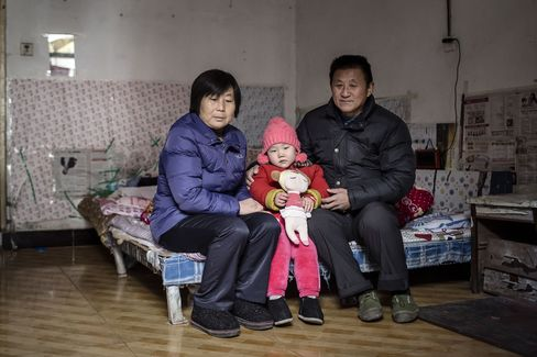Jingjing, 4, with her grandparents Li Defang, left, and Zhao Benyou
