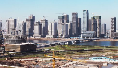 This 2012 photo shows modern office buildings under construction in the city of Tianjin's replica of Manhattan, which remains unoccupied.