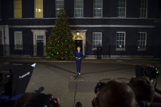 May Survives Confidence Vote to Face Uphill Struggle in Brexit
