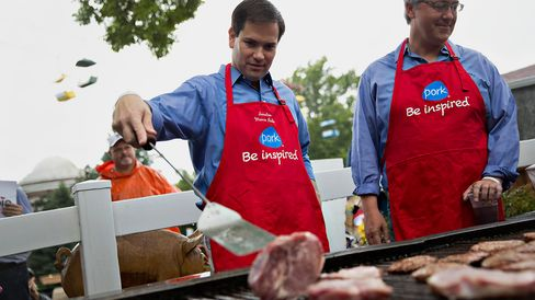 Senator Marco Rubio flips pork burgers at the Iowa Pork Producers booth during the Iowa State Fair in Des Moines on Aug. 18, 2015.