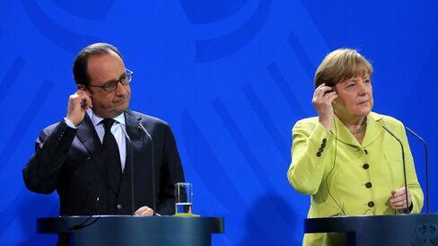 German Chancellor Angela Merkel And France's President Francois Hollande News Conference